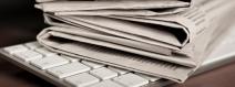 Newspaper on a computer keyboard