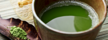 Green tea cup and leaves