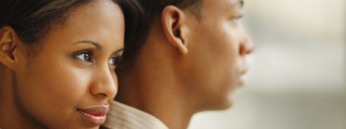 Closeup portrait of a serious young African American couple